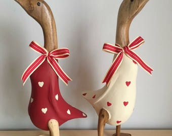 Red and cream heart opposite duck pair