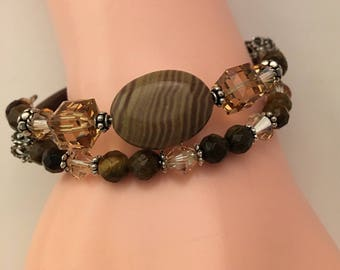 Peanut Jasper and Tigereye gemstone double row memory wire bracelet with Swarovski Crystals and sterling silver.