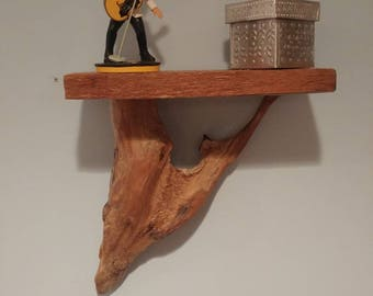 Wall mounted driftwood shelf with cedar top