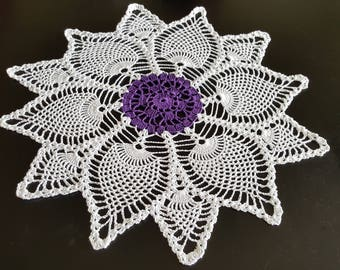 12 point pineapple doily,white with purple.