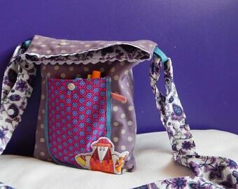 Hand bag, adjustable shoulder strap, fully lined with pockets.