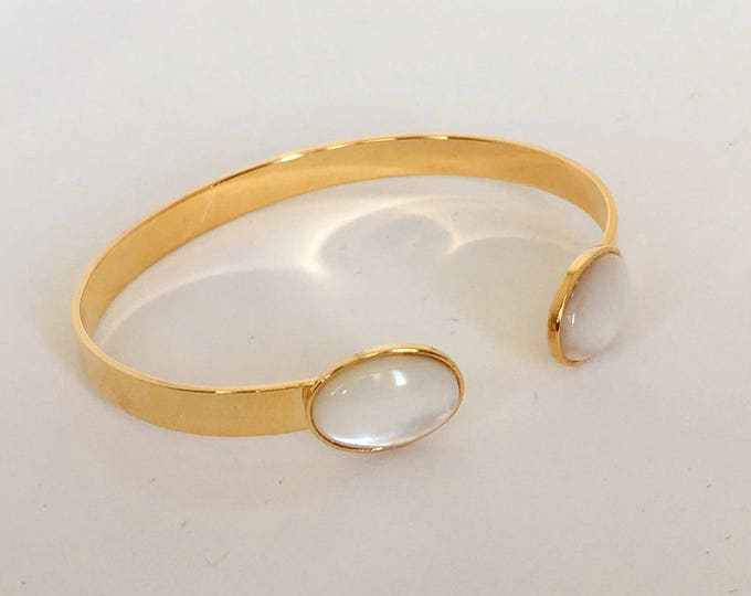 Gemstone bracelet, bangle bracelet with a gold finish and mother of pearl semi precious stone