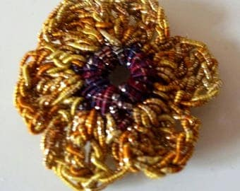 Yellow and purple brooch