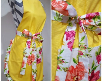 Adult apron. Woman's apron. Bright yellow on main with tiny polka dots. Pink, coral and yellow floral on pocket,  ties and frills.