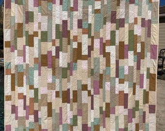 """Original modern quilt in contemporary neutrals/low-volume. Cozy snuggly throw approx 54""""x75"""" Brown/Tan/Off-White/pink/green solid fabrics"""