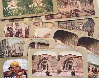 Lot of vintage stereoscopic cards dipicting religious scenes, children, animals, and landmarks.