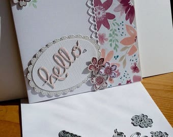 A blank square white card, handmade, handcrafted, embellished.