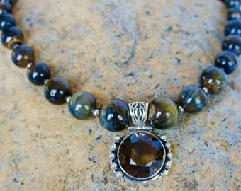 Strand of 20mm to 12mm Round Blue Tigereye Beads with Smoky Quartz Pendant in Sterling Silver Necklace with Matching Earrings.