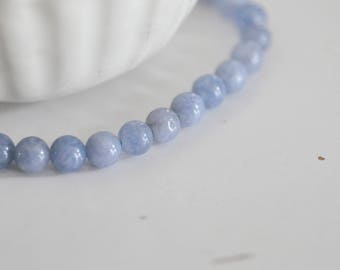Set of 10 blue grey jade round beads