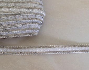 Braid has customize beaded in the middle of 1 cm and Silver trim white color