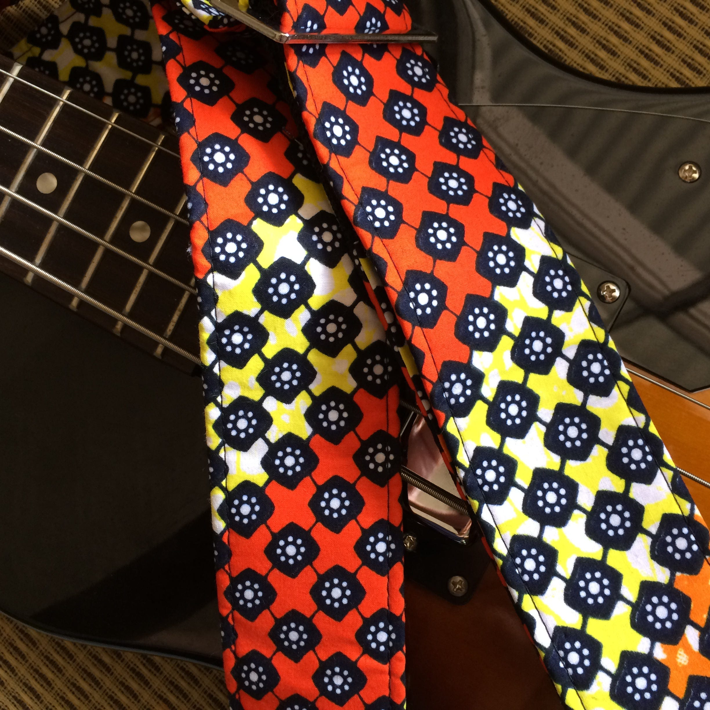 African guitar strap // wax print fabric in orange, black and ...