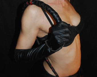 Red and black soft leather whip