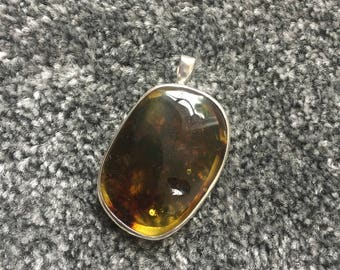 silver handmade pendant with amber