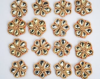 Set of 16 jewelled flower motifs