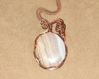 194 Spiral wrapped translucent sowbelly agate with gold coloration