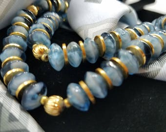 Gorgeous Art Glass Swirled Blue Beads with Gold Tone Disc Beads Necklace