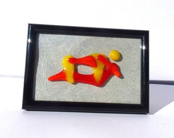 """Picture frame black and in its Center a fusing """"ORANGE and yellow"""""""