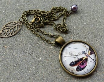 Fancy chain necklace and pendant over brass glass cabochon