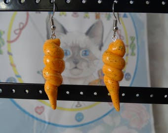 glittery orange swirl earrings