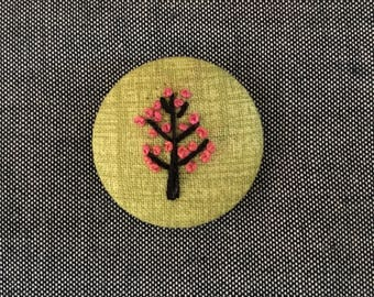 Fabric-covered button pin - cherry tree