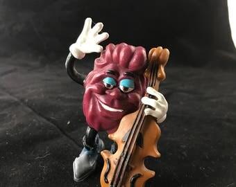 "1988 Applause Toys, California Raisins PVC toy.  Bass Guitarist. 3.25"" tall"