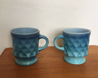 Two blue mid century Anchor Hocking Fire-king mugs