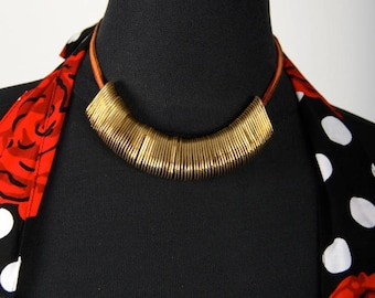 Necklace with a golden capsules