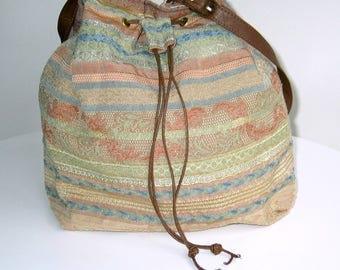 Drawstring bucket bag, shoulder bag, handbag. Made from all UPCYCLED materials.