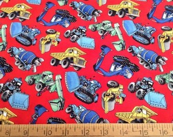 Construction trucks on red background cotton fabric by the yard