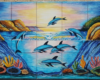 Beautiful tile mural reproduced depicts a dolphin family in the ocean.