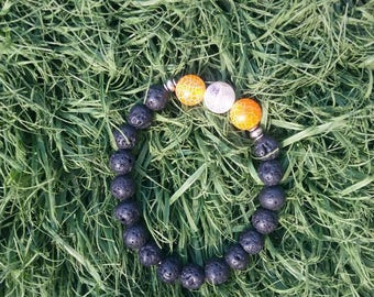 Orange and white lava bead bracelet