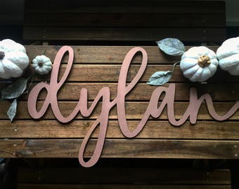Custom large name sign measuring approximately 28 inches long