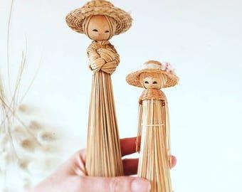 Pair of vintage straw dolls
