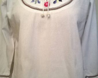 Hand-embroidered white cotton blouse