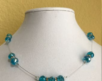An ultra light weight blue crystal floating necklace
