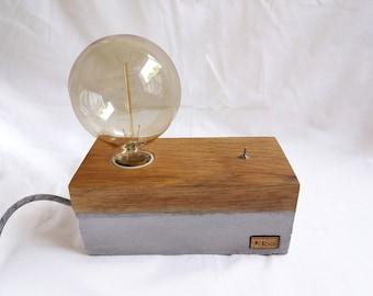Description of ambient lamp of concrete and oak with Edison bulb