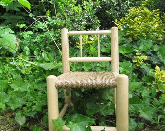 Wooden teddy bear or doll's chair with woven seagrass seat