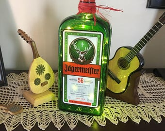 Jagermeister liquior bottle with Red LED lights or your choice of colored lights . Great for a big fan of this liquor favorite