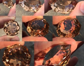 The huge Champagne Topaz from Pakistan.