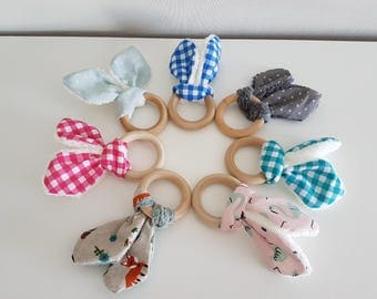 Wooden teething ring with rabbit rattle