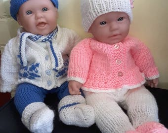 Dolls with handknitted outfits.