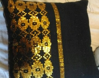 Homemade gold and black cushion