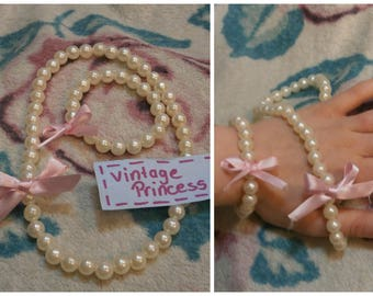 Vintage style Pearls with Pink Bows