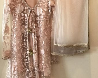 Beautiful net lace suit with tulip pants and net dupaata .