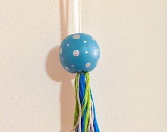 Light Blue Ornament with Silver Dots and Blue/Green Tassel