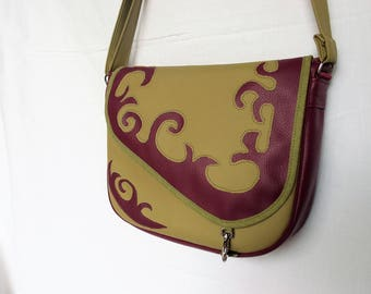 Lime green and Eggplant Purple faux leather satchel, cuts on the flap.