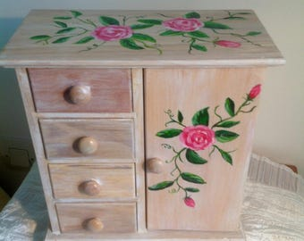 Large wooden cabinet makeover in jewelry box with roses