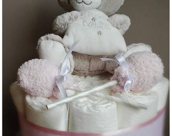 Diaper cake and its musical Teddy bear for the birth of a girl