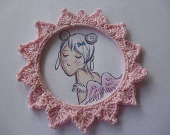 Round frame in pink cotton crocheted