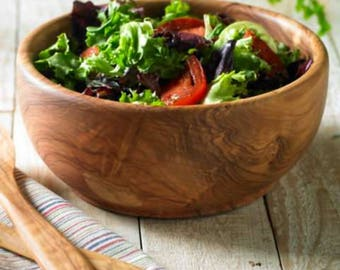 A rustic salad bowl made with olive wood